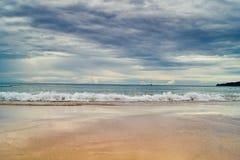 Spiaggia e nuvole Fotografia Stock