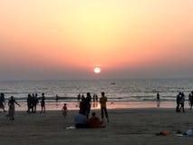 Spiaggia e tramonto Fotografie Stock Libere da Diritti