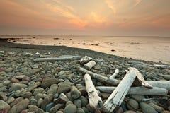 Spiaggia e tramonto Fotografia Stock