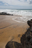 Spiaggia rocciosa Immagine Stock