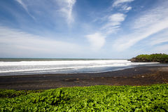 Spiaggia sabbiosa nera Fotografia Stock