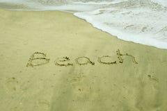 Spiaggia scritta in sabbia Fotografia Stock