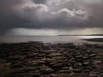 Spiaggia scura Fotografia Stock
