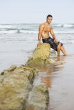 Spiaggia sexy dell'uomo Fotografie Stock