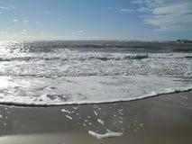 Spiaggia spumosa Immagini Stock