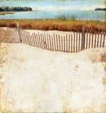 Spiaggia su una priorità bassa di Grunge fotografia stock libera da diritti