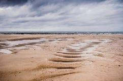 Spiaggia vuota nella bassa marea Fotografie Stock