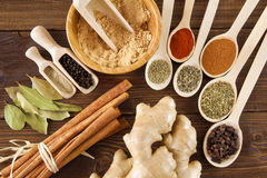 Spice assortment on a wooden table Royalty Free Stock Photo