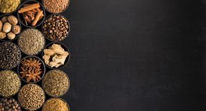 European spices in vintage style, top view. seasoning on black royalty free stock photography