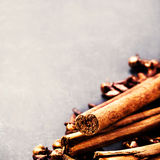Spice background - various spices over dark table Royalty Free Stock Photos