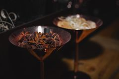 Spice badian in copper pot. Spice badian in a copper pot royalty free stock photos