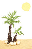 Spice beach. Spice palm, sun and sand; on white background Stock Image