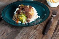Spice beef with rice. Spice beef with rice and vegetables Stock Photos