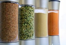 Spice Bottles. Four spice jars in a row Royalty Free Stock Photos