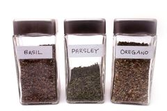 Spice bottles (clipping path). Basil, Parsley and Oregano Stock Images