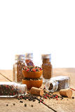 Spice bottles on rustic table Stock Photo