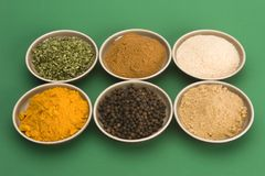 Spice bowls. Against a plain background Royalty Free Stock Images