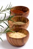 Spice Bowls 2. Wooden spice bowls filled with colorful spices Royalty Free Stock Photography