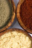 Spice Bowls 3. Wooden spice bowls filled with colorful spices Stock Photo