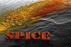 spice cúrcuma, paprika em um fundo estrutural preto fotografia de stock royalty free