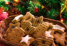 Spice-cakes. On the christmas tree background Royalty Free Stock Image