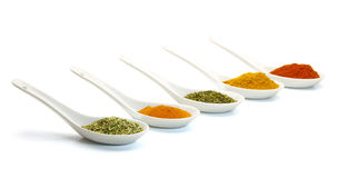 Spice in ceramic spoon. On white background Stock Photos