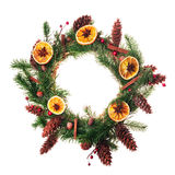 Spice Christmas wreath. Christmas wreath with dry orange slices and cinnamon sticks royalty free stock image