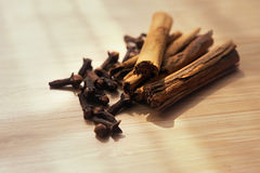 Spice cinnamon clove on a wooden board Royalty Free Stock Photography