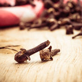 Spice cloves on kitchen table Stock Images