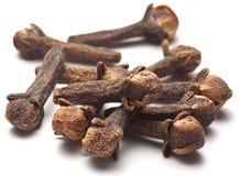 Spice cloves on white. Stock Photos