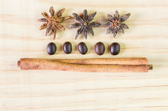 Spice and coffee beans on wooden table. Top view with copy space Stock Photo