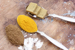 Spice. Collection of different spice like coriander, stock cubes and turmeric on metal spoon on rustic wooden background Stock Photo