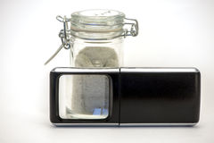 Spice Container and Magnifier. Image of a spice container and magnifier Royalty Free Stock Photo