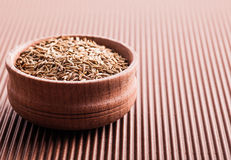 Spice cumin in a wooden bowl Royalty Free Stock Photo