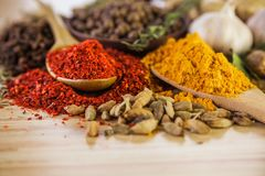 Spice. Curry powder herb seasoning wood cutting board turmeric Stock Photos