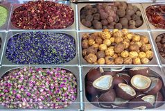 Spice and dried herb counter on the old market, Dubai, UAE. Rose, dried lemon, star anise, mint, coconut halves and hibiscus. Spice and dried herb counter on royalty free stock photos