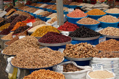 Spice fruits dried nuts almonds figs market market Stock Images