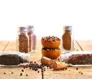 Spice glass containers on old wood table Stock Image