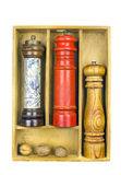 Spice grinders in a wooden box Royalty Free Stock Image