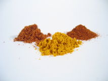Spice Heaps. Three spice heaps - curry, nutmeg and chili stock photos