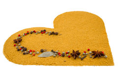 Spice heart with anise stars and cinnamon Royalty Free Stock Photos