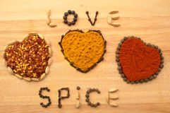 Spice Hearts. On a wooden board spices used to write words love spice Stock Photography