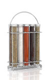 Spice and Herb Rack. Of sage, rosemary,  sea salt, cayenne pepper, black peppercorns and parsley over white background Royalty Free Stock Photos