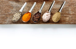 Spice and herbs in steel spoon Stock Photo
