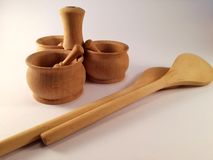 The spice holder and the wooden spoon are an important part of a kitchen stock photography