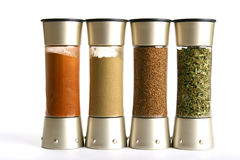 Spice Jars. Four spice bottles in a row Royalty Free Stock Image