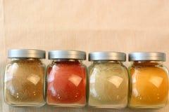 Spice Jars. Indian spice jars containing garam masala, ground red chillies, ground cumin and turmeric stock photo