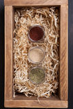 Spice jars in a crate Royalty Free Stock Photography