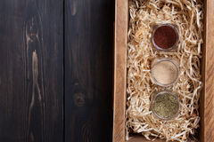 Spice jars in a crate Stock Photo