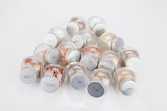 Spice jars. Spice glass containers on a white surface. Spice jars on white background stock photos